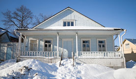 Rural wooden house with snowdrifts Stock Photo