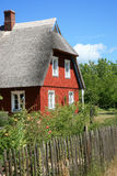 Rural wooden house with thatched roof Royalty Free Stock Image