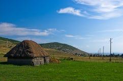 Rural wooden lodge at Pešter plateau landscape Stock Photos