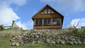 Rural wooden summer house stone hill cloud flow blue sky stock video footage