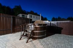 Rural wooden water hot tub with stairs garden yard. . night and starry sky Royalty Free Stock Images