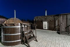 Rural wooden water hot tub with stairs garden yard. . night and starry sky Stock Images