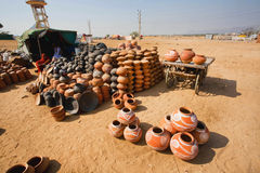 Rural workers making clay pots for sale Stock Photo