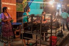 RURRENABAQUE, BOLIVIA - MAY 1, 2015: Streetside bbq restaurant in Rurrenabaque, Boliv. RURRENABAQUE, BOLIVIA - MAY 1, 2015: Streetside bbq restaurant in royalty free stock photos