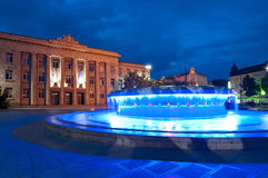 Ruse, Bulgaria. Water fountain at dusk in city center Royalty Free Stock Image