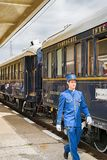 The legendary Venice Simplon Orient Express. Ruse city, Bulgaria - August 29, 2017. The butler. The legendary Venice Simplon Orient Express is ready to depart royalty free stock images