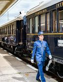 Orient Express The butler. Ruse city, Bulgaria - August 29, 2017. The legendary Venice Simplon Orient Express is ready to depart from Ruse Railway station. Bar royalty free stock photos