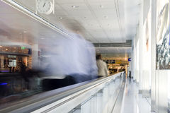 Rush. Blurred picture of people at the escalator of the airport Stock Photography