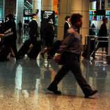 Rush. People walking at an airport stock photos