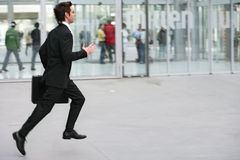 Rush. Businessman running with his executive case Stock Image