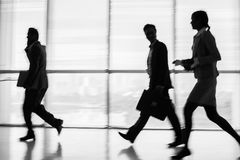In a rush. Business silhouettes in a rush inside stock photo