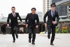 Rush business team run in city stock image