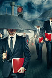 The rush. Businessman with umbrella in the rain Stock Images