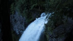 Sahalie falls in the evening. The rush of the crystal clear McKenzie River over Sahalie Falls is still strong in August of 2019 stock footage
