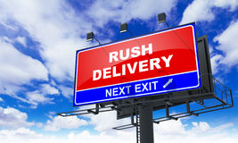 Rush Delivery on Red Billboard. Stock Photos
