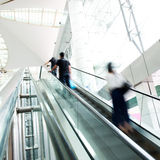 Rush on escalator Stock Photos
