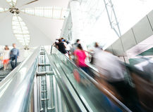 Rush on escalator stock photo