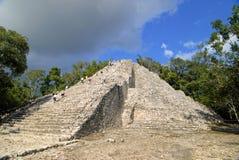 Rush hour. Toursit climbing the big pyramid in Coba, Mexico Stock Photo