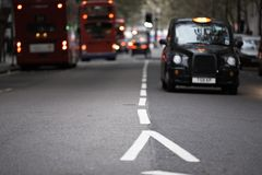 Rush hour. In London - selective focus on dividing line royalty free stock photography