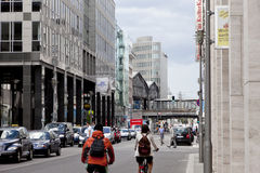 Rush Hour in Berlin. Berlin, Germany - August 8, 2011: This is rush hour on Friedrichstrasse in Berlin. A line of cars is driving in the left of the picture and Royalty Free Stock Image