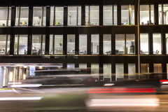 Rush hour. In the city with office building and traffic lights during night stock image