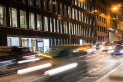 Rush hour in the city. With office building and traffic lights during night stock images