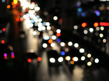 Rush Hour on a City Road at Night. Blurred Defocused Lights of Heavy Traffic on a City Road at Night - Commuting Concept Stock Image