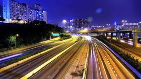 Rush Hour. City Traffic. Wide Tilt Down Shot. Busy cars on board and multi lanes highway. Night City timelapse stock video footage