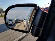 Rush Hour Commuter Traffic Jam. As seen in the rear view mirror Stock Images