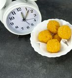 Rush hour eating lunch. cheese ball in a white dish on a stone floor table stock images