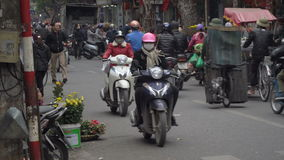 Rush hour in Hanoi. HANOI, VIETNAM - 5 DECEMBER 2016: Rush hour in Hanoi, motorbikes and other traffic navigate through busy streets, Vietnam infrastructure and stock video footage