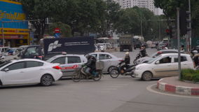 Rush hour in Hanoi. HANOI, VIETNAM - 5 DECEMBER 2016: Rush hour in Hanoi, motorbikes and other traffic navigate through busy streets, Vietnam infrastructure and stock footage