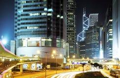 Rush Hour Hong Kong Cityscape at Night. Hong Kong Cityscape at Night. Corporate building at the back and busy traffic across the main road at rush hour royalty free stock photos