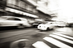 Rush hour I. Panning following a car a pass by on a street Royalty Free Stock Image