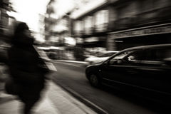 Rush hour II. Panning following a car a pass by on a street Stock Photo