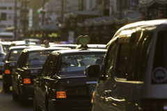 Rush hour japan. Taxi snake in the evening traffic Stock Photos