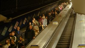 Rush hour in London underground. People on the escalator. London, UK. Rush hour in London underground. People on the escalator. London, United Kingdom stock footage