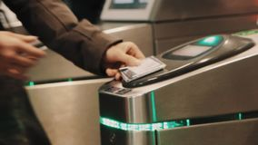Rush hour metro wicket control panel, people paying for enter with cards. Rush hour metro metal wicket control panel with green lights, people paying for enter stock video footage