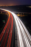 Rush hour at night. Rush hour traffic shot from above a busy road Night photo of motorway showing streaking trails of light Stock Images