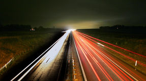 Rush hour Night traffic. Road at night with fast traffick, rush hour commuter in cars, transport home Royalty Free Stock Photo