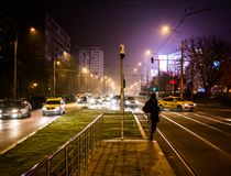 Urban landscape in rush hour. Rush hour photo taken in Bucharest when colder weather push people to excessive usage of cars Stock Image