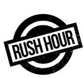 Rush Hour rubber stamp. Grunge design with dust scratches. Effects can be easily removed for a clean, crisp look. Color is easily changed Stock Images