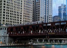 Rush hour scene of Chicago`s elevated `el` train track passing over the Chicago River. Stock Photo