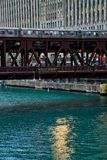 Rush hour scene of elevated train track for Chicago's elevated `el` passing over the Chicago River. stock images