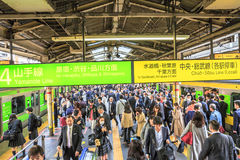 Rush hour Shinjuku Station. Tokyo, Japan - April 17, 2017: commuters at rush hour in Shinjuku Station. Yamanote Line loop that connects all metro lines and Sobu Royalty Free Stock Images