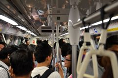 Rush hour on Singapores subway trains Royalty Free Stock Photo