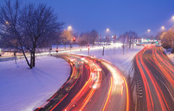 Rush hour in snow. Rush hour traffic in the evening on a crossroad with snow Royalty Free Stock Photo