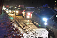 Traffic jam on the snow-covered road Stock Images