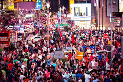 Rush hour at Times Square. NEW YORK CITY - JULY 2: Rush hour at Times Square. Times Square featured with Broadway Theaters and animated LED signs is a symbol of royalty free stock photo