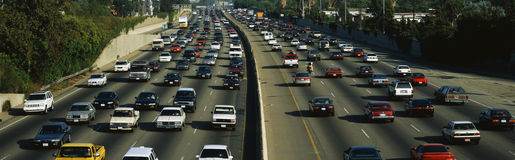 Rush hour traffic. This is rush hour traffic on the 405 Freeway at sunset. There are 10 total lanes of traffic with cars traveling in both directions stock photo